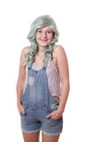 Young woman with green hair and jeans dungarees Stock Image
