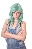 Young woman with green hair sulking Stock Photo