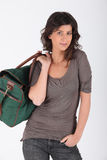 Young woman with green holdall Stock Photos