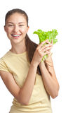 Young woman with green lettuce Royalty Free Stock Photography