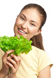 Young woman with green lettuce Stock Image