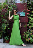 Young woman in green long dress Stock Photos