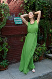 Young woman in green long dress Stock Image