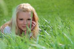 Young woman on green meadow Stock Photo