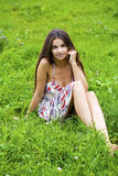 Young woman on green meadow Stock Image