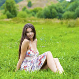 Young woman on green meadow Royalty Free Stock Images