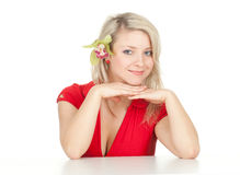 Young woman with green orchid Stock Photo