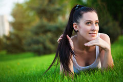 Young woman in a green park. summer. Young woman lying in a green park Stock Photography