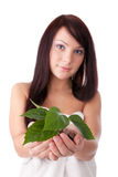 Young woman with green plant. Stock Photos