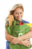 Young woman with green recycled grocery bag. Close-up of young woman with green recycled grocery bag of healthy food and vegetables Stock Photos