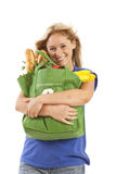 Young woman with green recycled grocery bag. Close-up of young woman with green recycled grocery bag of healthy food and vegetables Stock Photography