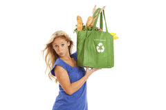 Young woman with green recycled grocery bag. Humorous portrait of young woman with green recycle bag Stock Image
