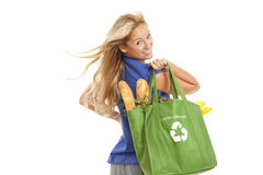 Young woman with green recycled grocery bag. Of healthy food and vegetables Royalty Free Stock Image