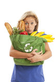 Young woman with green recycled grocery bag. Humorous portrait of young woman with green recycle bag Stock Photos