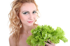 Young woman with green salad Royalty Free Stock Image