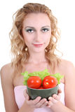 Young woman with green salad an tomatoes Royalty Free Stock Photos