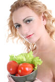 Young woman with green salad an tomatoes Royalty Free Stock Images