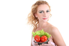 Young woman with green salad an tomatoes Stock Images