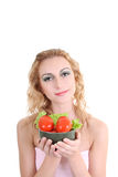 Young woman with green salad an tomatoes Stock Image