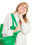 Young woman with green shopping bag Royalty Free Stock Image