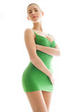 Young woman in green slip Stock Image
