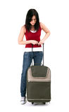 Young woman with green suitcase Royalty Free Stock Photos