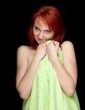 Young woman in green towel Royalty Free Stock Image