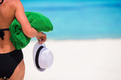 Young woman with green towel and hat on white Royalty Free Stock Images
