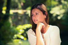Young woman  among green trees Stock Photography