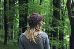 Young woman in the green woods Royalty Free Stock Images