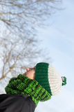Young woman with a green wool cap and a scarf Stock Photos