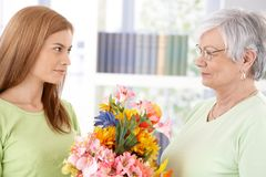 Young woman greeting mother at mother's day Royalty Free Stock Image