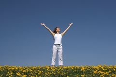 Young woman greets the sun Stock Photo