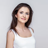 Young woman on grey background Royalty Free Stock Photos