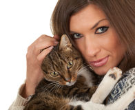 Young woman with grey  cat Royalty Free Stock Photos
