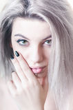 Young woman with grey hair portrait. Young woman with grey hair closeup portrait with hand Royalty Free Stock Photo