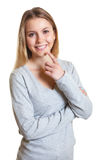Young woman in a grey sweater looking at camera Royalty Free Stock Photo