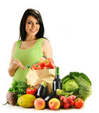 Young woman and groceries isolated on white Royalty Free Stock Photos