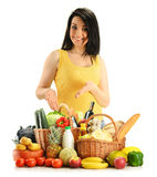 Young woman and groceries isolated on white Stock Image