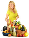 Young woman with groceries isolated on white Royalty Free Stock Photography