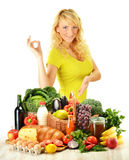 Young woman with groceries isolated on white Stock Image