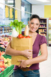 Young woman with grocery bag in market stock photo