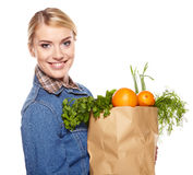 Young woman with a grocery shopping bag. Royalty Free Stock Image