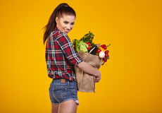 Young woman with a grocery shopping bag. Royalty Free Stock Photography