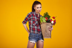 Young woman with a grocery shopping bag. Stock Photo
