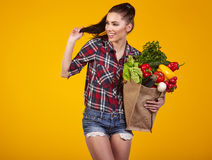 Young woman with a grocery shopping bag. Royalty Free Stock Photos