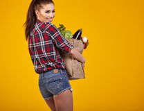 Young woman with a grocery shopping bag. Royalty Free Stock Images