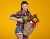 Young woman with a grocery shopping bag. Royalty Free Stock Photo