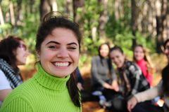 Young woman with a group of friends. Group of teen girls on vacation during a trip in the forest stock photography