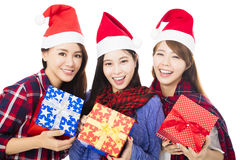 Young woman group in santa hat with gift box Royalty Free Stock Photography